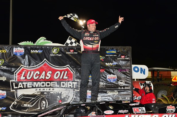 Earl Pearson celebrates winning the DART Winternationals race at the Lucas Oil Model Dirt Series in Tampa, Fla. (image courtesy of Bobby Labonte Racing)