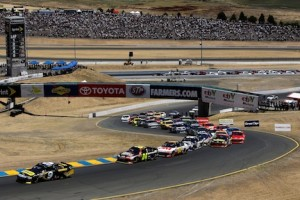 Marcos Ambrose leads the field after a the start of the Toyota/Save Mart 350 at Sonoma on Sunday, June 24, 2012. (Credit: 257894 By Tom Pennington, Getty Images) (Used with permission of NASCAR.)